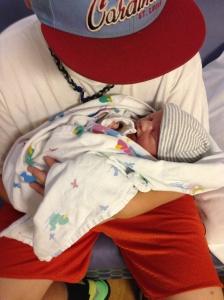 Josh holding Miller baby